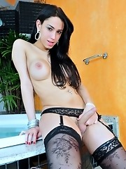 Naughty transsexual seducing in sexy black stockings