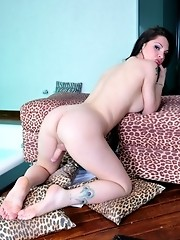 Busty transsexual brunette shows her perfect asshole